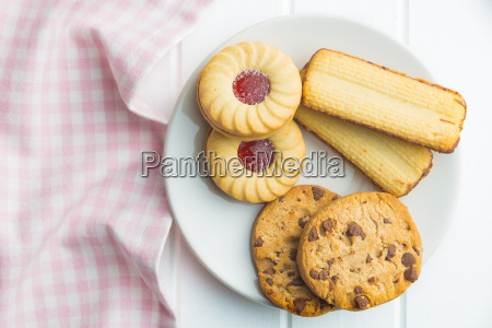 various sweet biscuits on plate