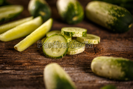 slices and whole fresh cucumber