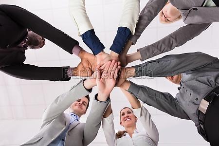 business team stacking hands together