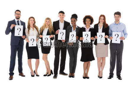 businesspeople holding question mark sign