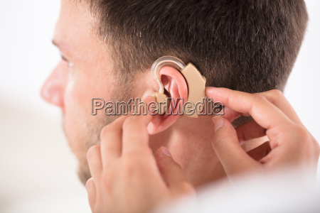 person with a hearing aid