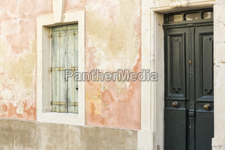 weathered house wall with window and
