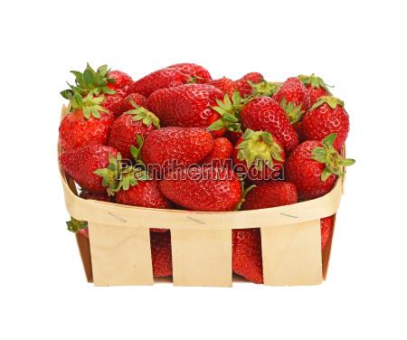 red ripe strawberries in wooden basket