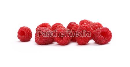 fresh red ripe raspberries on white