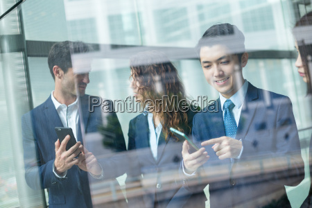 group of business people discuss somehting