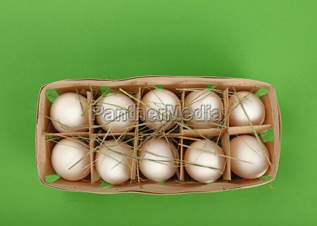 white chicken eggs in wooden container