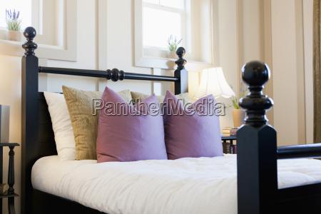 cushions arranged on bed valencia california