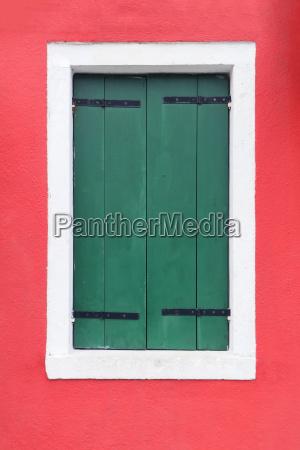closed green window shutters