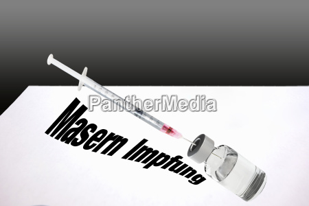 syringe is filled with vaccine for