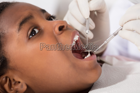 african girl with mouth open during