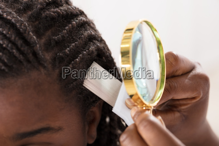 dermatologist looking at patients hair