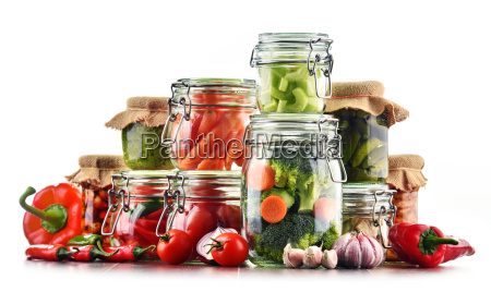 jars with marinated food and raw