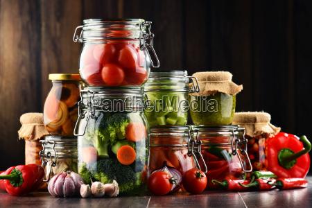 jars with marinated food and organic