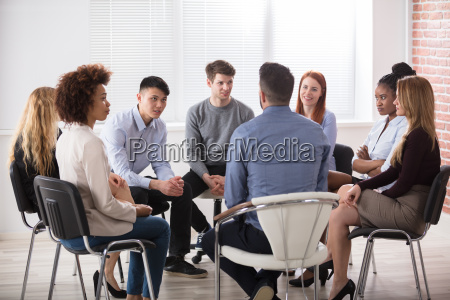 group of businesspeople sitting on chair