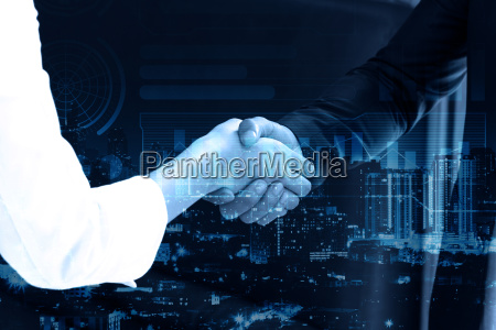 double exposure business people shaking hands