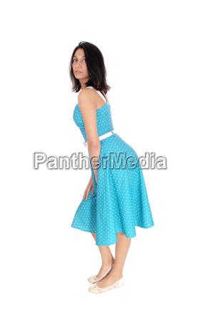 beautiful hispanic woman in blue dress