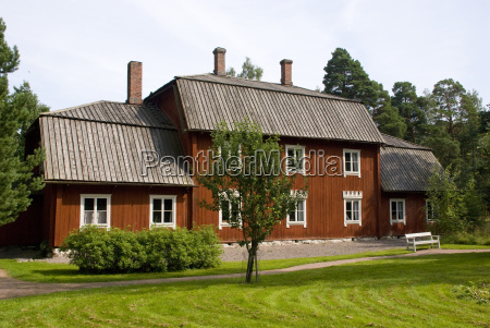 typical scandinavian red wooden house in