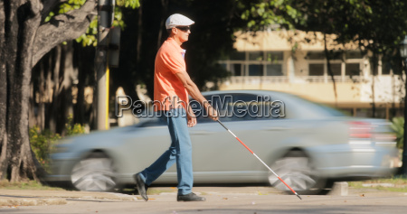 blind man crossing the road with