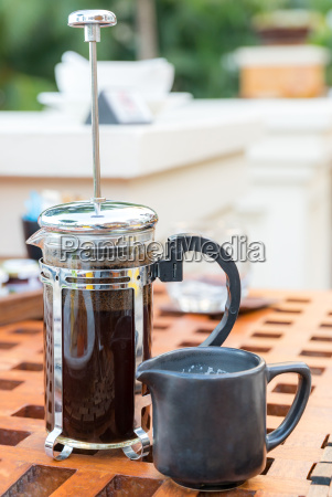 cup of black coffee and french
