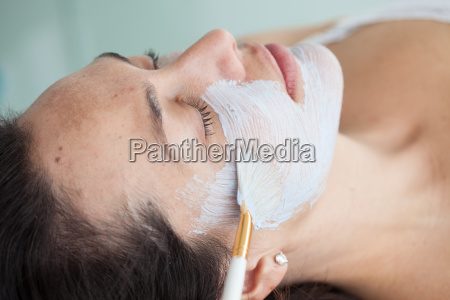 facial mask application on woman face