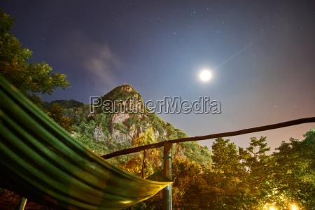 hammock at night with fullmoon and