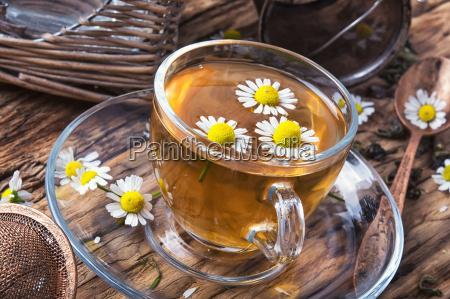 glass of herb tea with chamomile