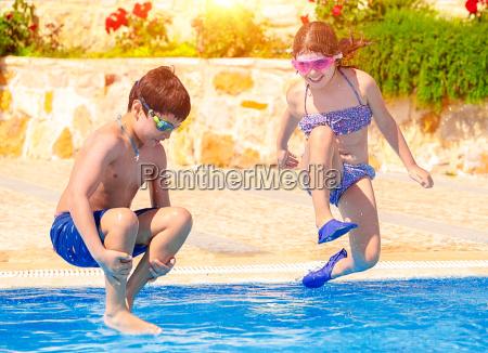 happy children in the pool
