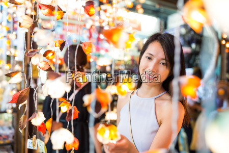 woman choosing the decoration lamp in
