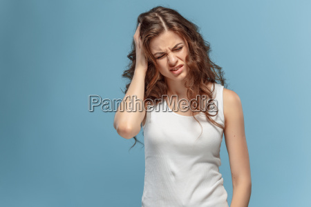 the young womans portrait with pain