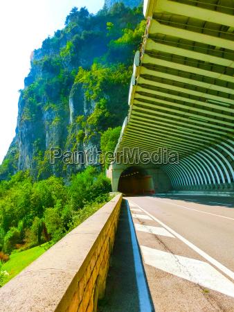 high mountains and road lake garda