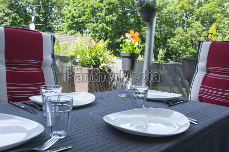 laid balcony table with white dishes