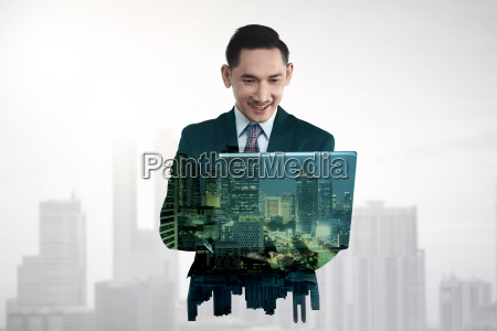 business man with multiple exposure holding