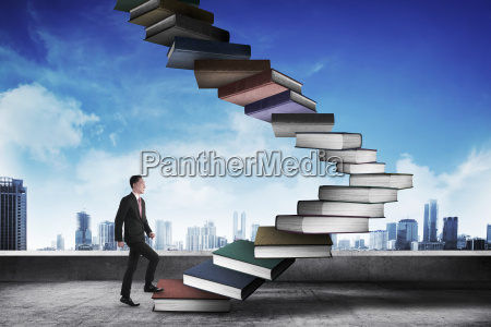 business person step up flying book