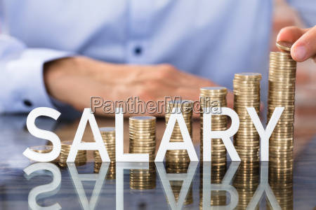 salary text in front of coins