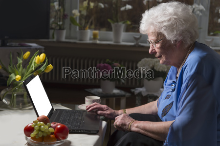 senior woman sitting in living room