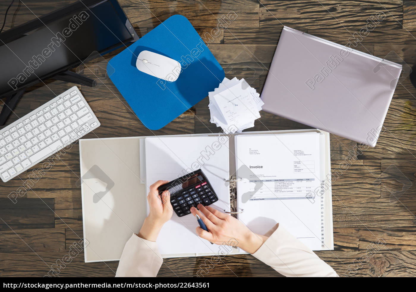 businesswoman, calculating, invoice, in, office - 22643561