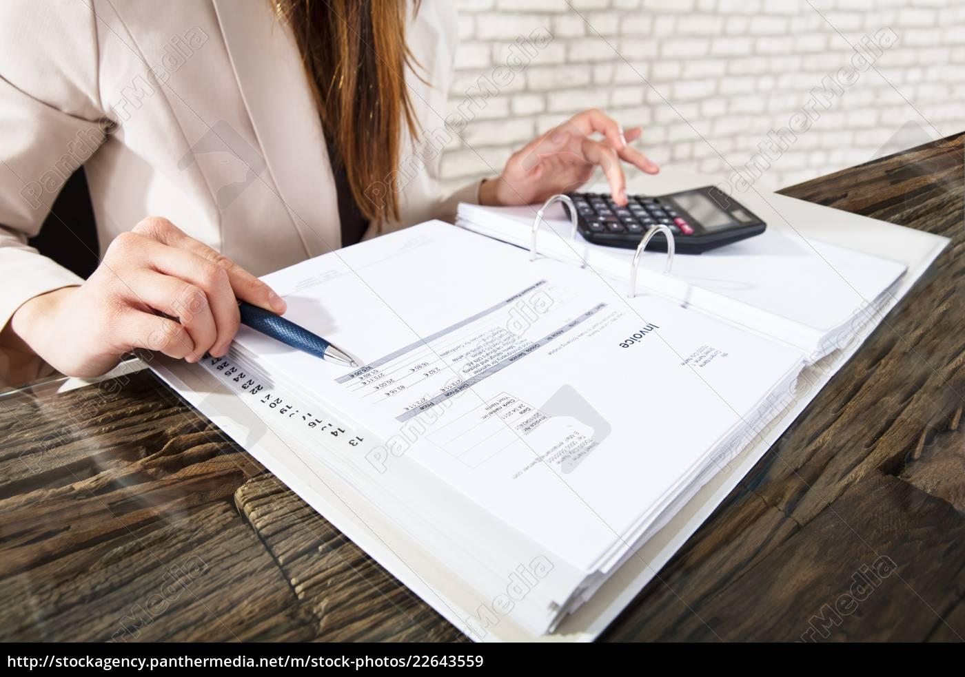 businesswoman, calculating, invoice - 22643559