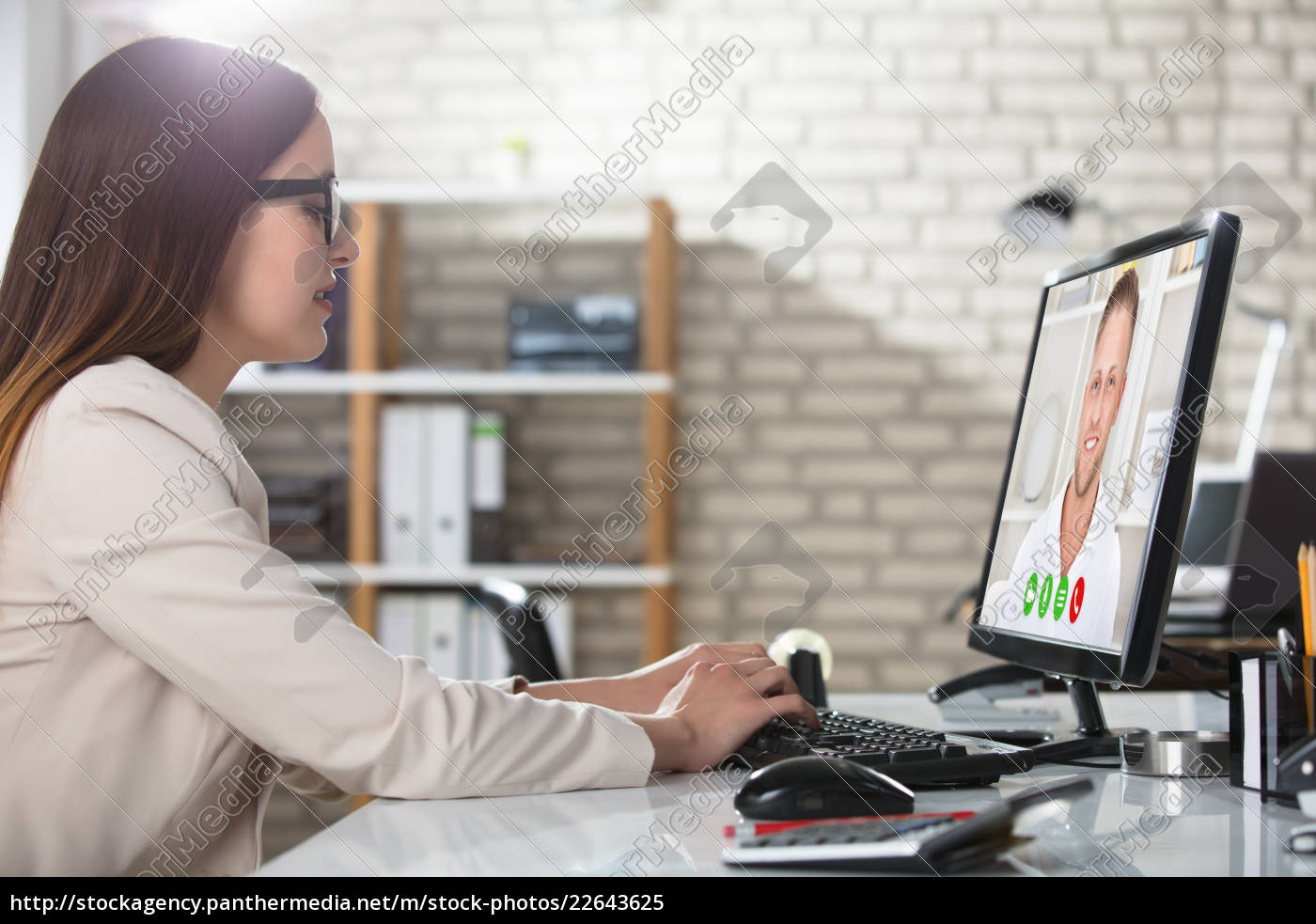 businesswoman, doing, video, conference, on, computer - 22643625