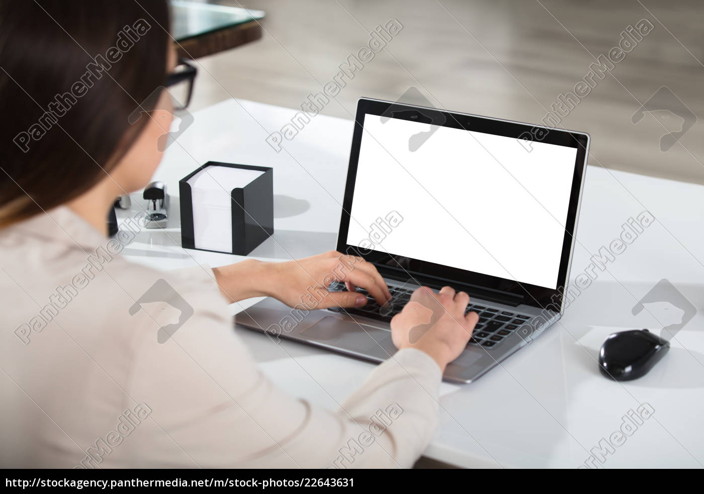 businesswoman, using, laptop, at, desk - 22643631