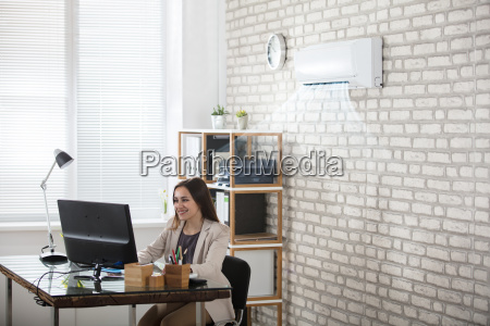 businesswoman, working, in, office, with, air - 22643551