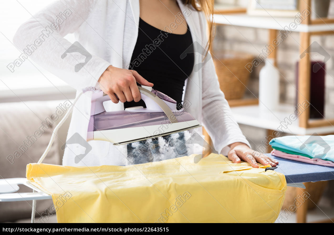 woman, ironing, clothes, with, steam, from - 22643515