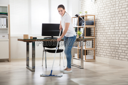 young, woman, cleaning, the, floor - 22643571