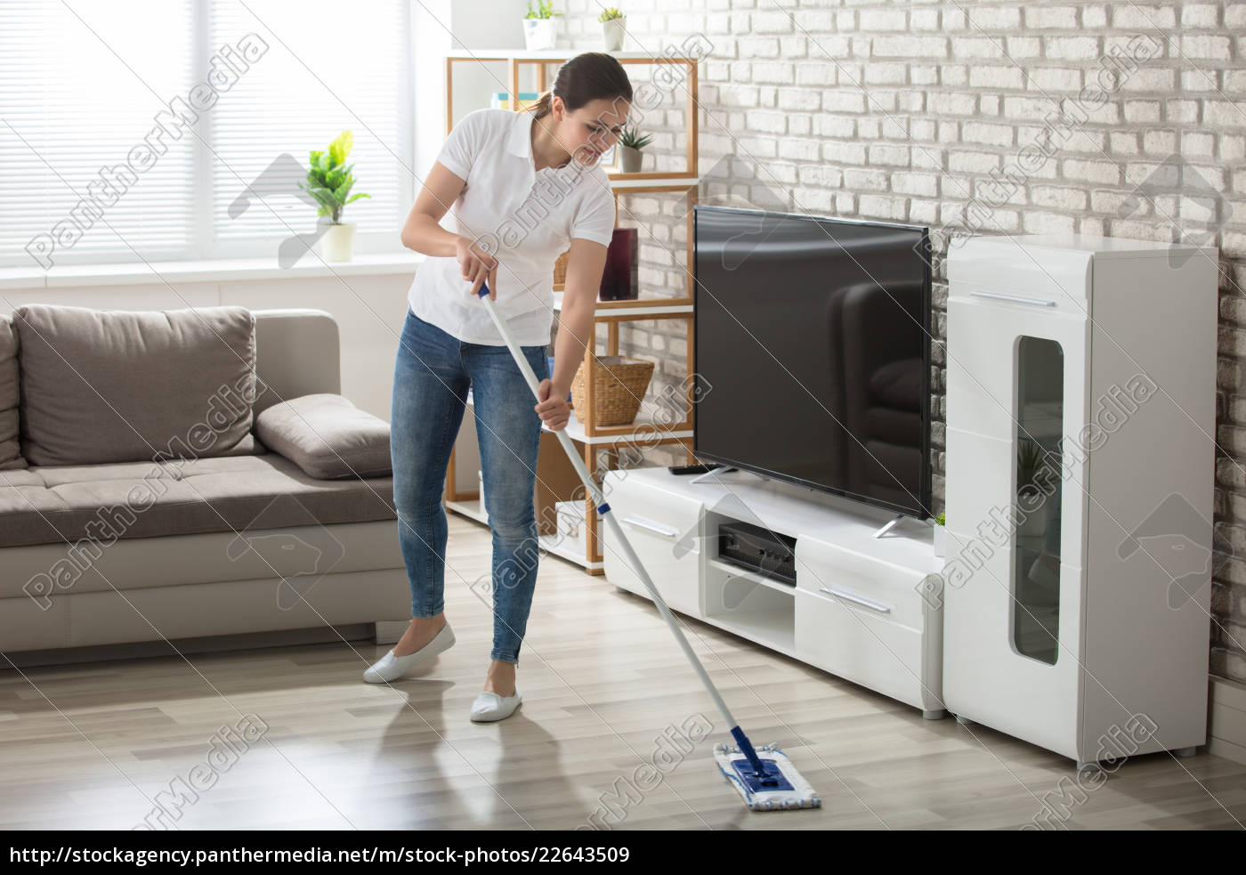 young, woman, cleaning, the, hardwood, floor - 22643509