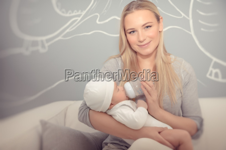 happy mother feeding her baby