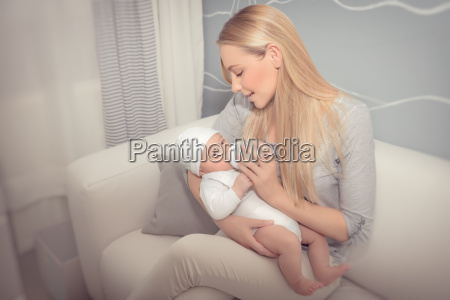 happy, mother, feeding, her, baby - 22646171