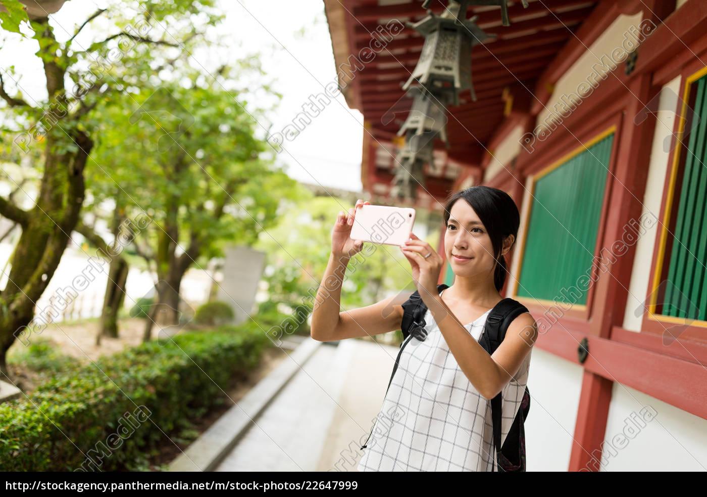 woman, taking, photo, in, dazaifu, tenmangu - 22647999