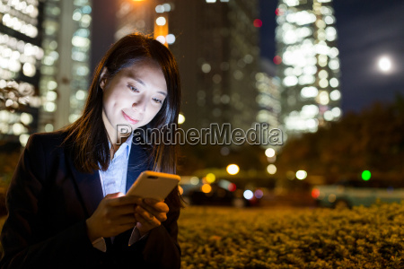 business, woman, working, at, night, in - 22648145