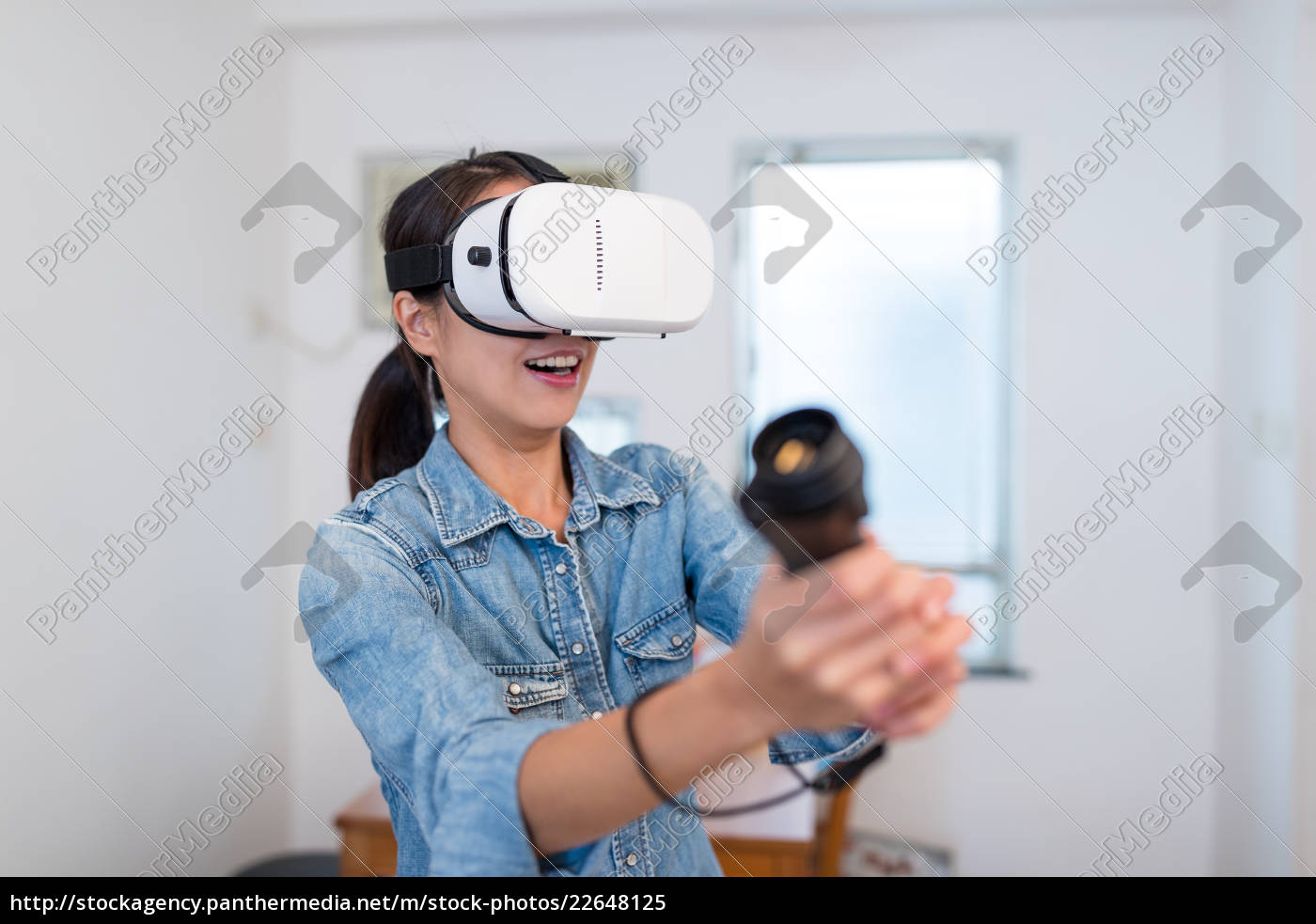 thrilled, woman, play, game, with, virtual - 22648125