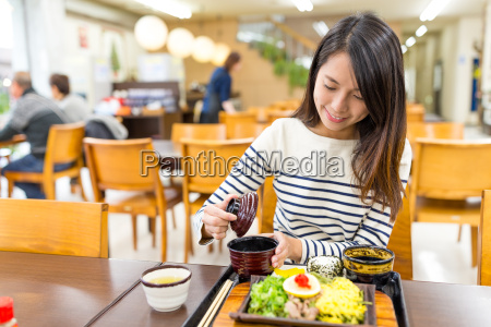 woman, enjoy, her, meal, in, restaurant - 22648219