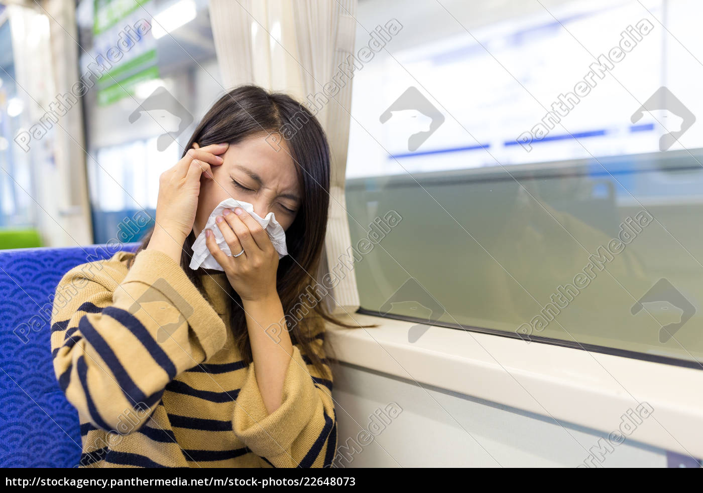 woman, sneezing, inside, train, compartment - 22648073
